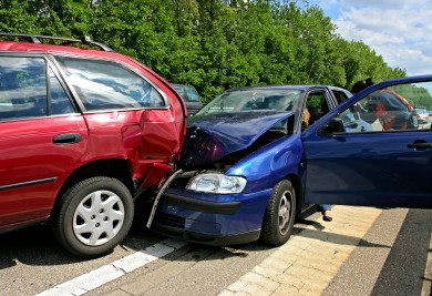 blue and red car highway accident