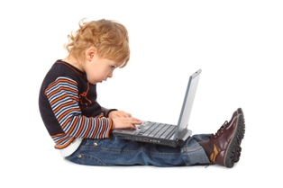 sitting boy with laptop