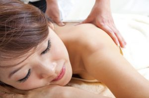 Woman getting therapeutic massage in Redmond, OR